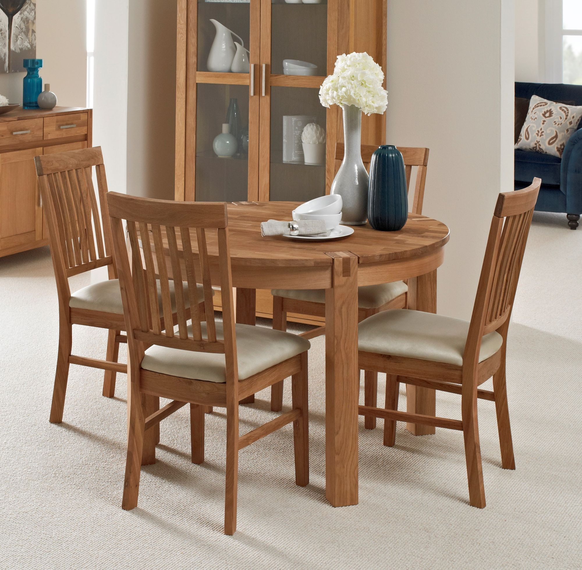 Living homes collection regis oak round extending dining table 4 fabric chairs dining sets living homes